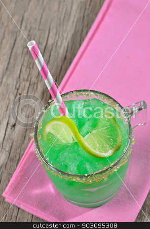 cocktail glass stock photo, cocktail with lime and ice on wooden background by Iordache Magdalena