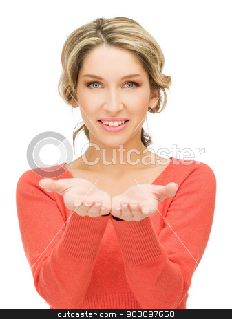 something on the palms stock photo, smiling woman showing something on the palms of her hands by Syda Productions