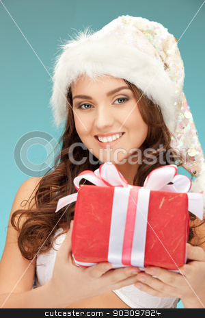 cheerful santa helper girl with gift box stock photo, picture of cheerful santa helper girl with gift box... by Syda Productions