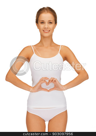 woman forming heart shape on belly stock photo, picture of beautiful woman in cotton undrewear forming heart shape on belly . by Syda Productions