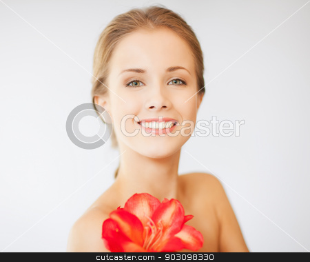 lovely woman with lily flower stock photo, bright picture of lovely woman with lily flower. by Syda Productions