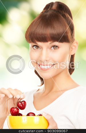 woman with cherries stock photo, bright picture of lovely woman with cherries by Syda Productions