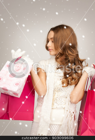 shopper stock photo, lovely woman with shopping bags over white. by Syda Productions