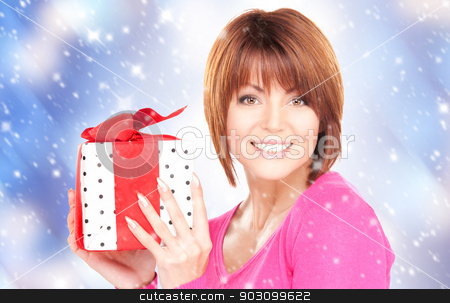 happy woman with gift box stock photo, happy woman with gift box over christmas lights by Syda Productions