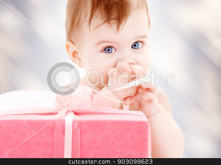 baby boy with gift box stock photo, picture of baby boy with big gift box by Syda Productions