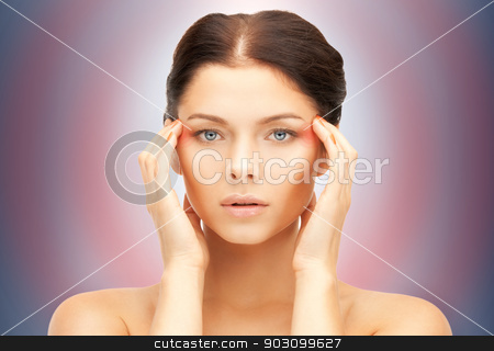 unhappy woman stock photo, bright picture of unhappy woman over blue by Syda Productions