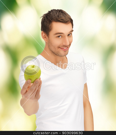 man in white shirt with green apple stock photo, handsome man in white shirt with green apple by Syda Productions