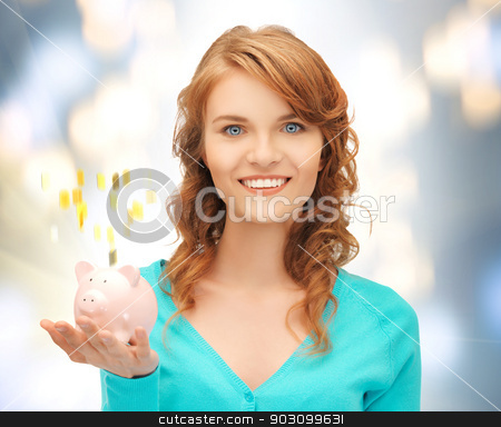 teenage girl with piggy bank stock photo, picture of teenage girl with piggy bank by Syda Productions