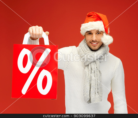 handsome man in christmas hat stock photo, bright picture of handsome man in christmas hat . by Syda Productions