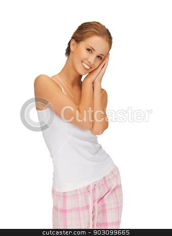 woman in cotton pajamas making sleeping gesture stock photo, picture of woman in cotton pajamas making sleeping gesture by Syda Productions