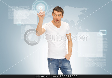handsome man working with touch screen stock photo, picture of handsome man working with touch screen by Syda Productions