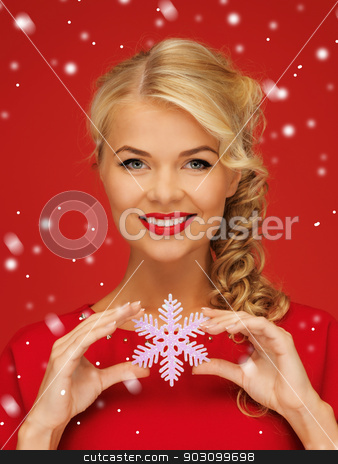 lovely woman in red dress with snowflake stock photo, picture of lovely woman in red dress with snowflake by Syda Productions