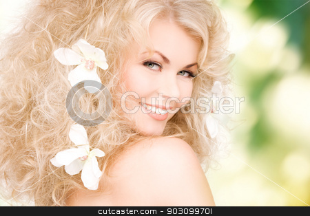 woman with flowers in hair stock photo, picture of happy woman with flowers in hair by Syda Productions