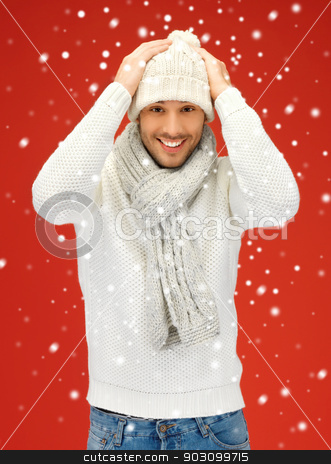 handsome man in warm sweater, hat and scarf stock photo, picture of handsome man in warm sweater, hat and scarf. by Syda Productions