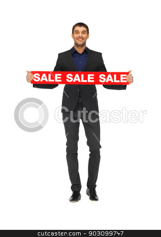 handsome man in suit with sale sign stock photo, picture of handsome man in suit with sale sign. by Syda Productions