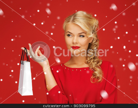 lovely woman in red dress with shopping bag stock photo, picture of lovely woman in red dress with shopping bag by Syda Productions