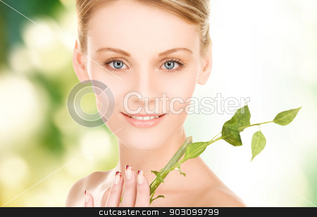 woman with sprout stock photo, picture of woman with sprout over green background by Syda Productions