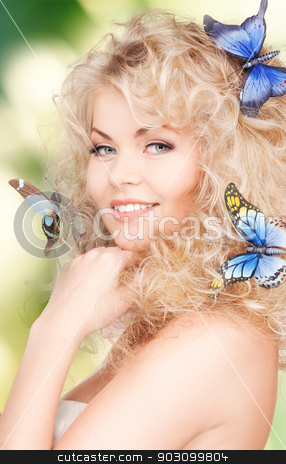woman with butterflies in hair stock photo, picture of happy woman with butterflies in hair by Syda Productions