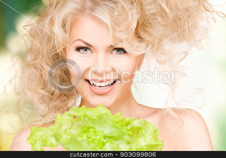 happy woman with lettuce stock photo, picture of happy woman with lettuce over green by Syda Productions