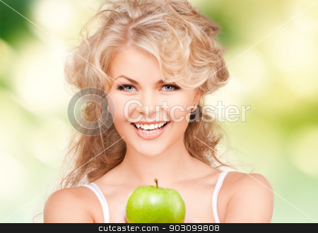 young beautiful woman with green apple stock photo, picture of young beautiful woman with green apple. by Syda Productions