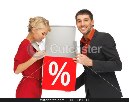 man and woman with percent sign stock photo, bright picture of man and woman with percent sign by Syda Productions