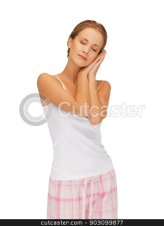 woman in cotton pajamas with closed eyes stock photo, bright picture of woman in cotton pajamas with closed eyes by Syda Productions