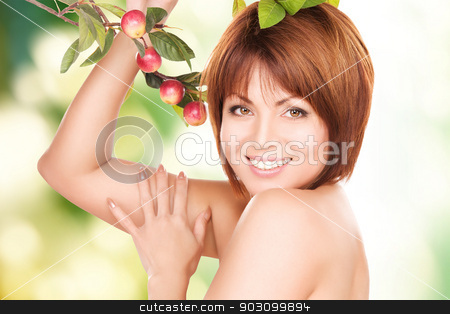 happy woman with apple twig stock photo, picture of happy woman with apple twig by Syda Productions