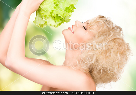 beautiful housewife with lettuce stock photo, bright picture of beautiful housewife with lettuce by Syda Productions