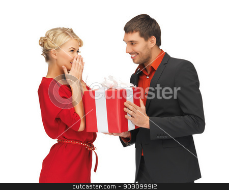 man and woman with present stock photo, picture of man and woman with present by Syda Productions
