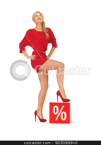 lovely woman in red dress with percent sign stock photo, picture of lovely woman in red dress with percent sign by Syda Productions