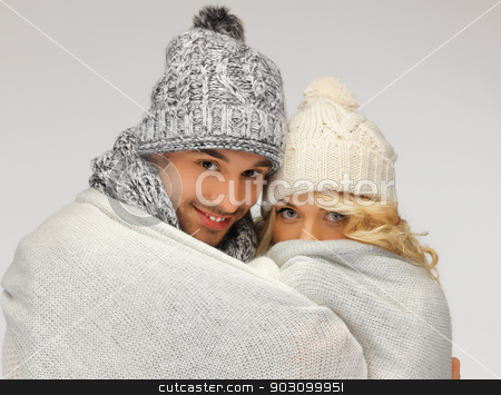 family couple under warm blanket stock photo, bright picture of family couple under warm blanket (focus on man) by Syda Productions