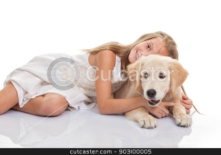 child hugging pet puppy dog stock photo, child hugging pet Labrador puppy dog by mandygodbehear