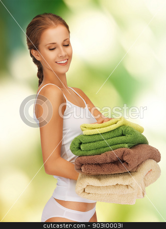 lovely woman with towels stock photo, bright picture of lovely woman with towels. by Syda Productions