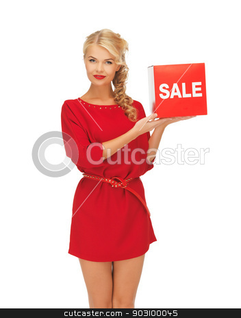 lovely woman in red dress with sale sign stock photo, picture of lovely woman in red dress with sale sign by Syda Productions