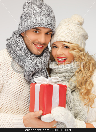 romantic couple in a sweaters with gift box stock photo, picture of romantic couple in a sweaters with gift box by Syda Productions