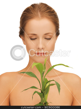 woman with green sprout stock photo, closeup picture of woman with green sprout. by Syda Productions