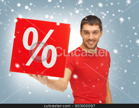 man with percent sign stock photo, picture of handsome man with percent sign (focus on box) by Syda Productions