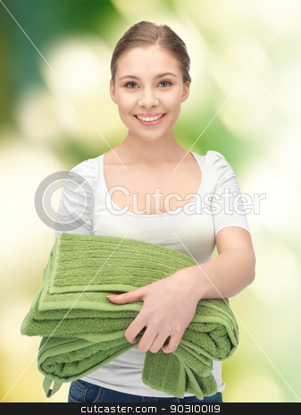 lovely housewife with towels stock photo, bright picture of lovely housewife with towels by Syda Productions