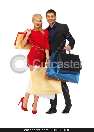 man and woman with shopping bags stock photo, bright picture of man and woman with shopping bags by Syda Productions