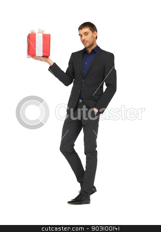 handsome man in suit with a gift box stock photo, picture of handsome man in suit with a gift box. by Syda Productions