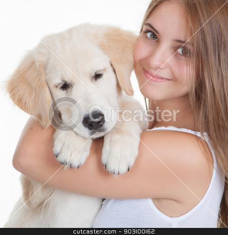 girl holding pet labrador puppy stock photo, girl holding pet golden labrador puppy by mandygodbehear