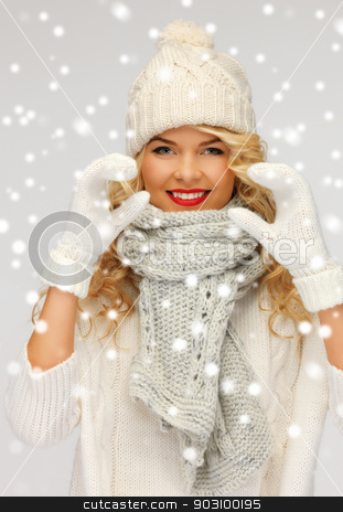 beautiful woman in a winter clothes showing heart stock photo, picture of beautiful woman in a winter clothes showing heart.. by Syda Productions