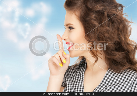 finger on lips stock photo, bright picture of young woman with finger on lips by Syda Productions