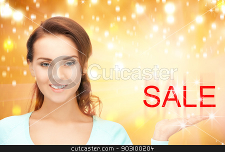 sale word on the palm stock photo, beautiful woman showing sale word on the palm of her hand by Syda Productions