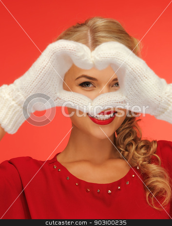 lovely woman showing heart shape stock photo, picture of lovely woman showing heart shape by Syda Productions