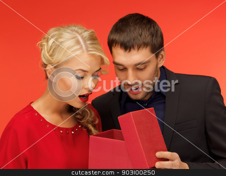 man and woman looking inside the gift box stock photo, picture of man and woman looking inside the box by Syda Productions