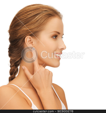 woman pointing to ear stock photo, picture of beautiful woman pointing to ear by Syda Productions