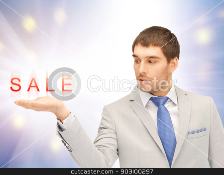 sale word on the palm stock photo, handsome man showing sale word on the palm of his hand by Syda Productions