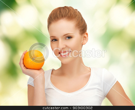 teenage girl with orange stock photo, picture of beautiful teenage girl with orange. by Syda Productions