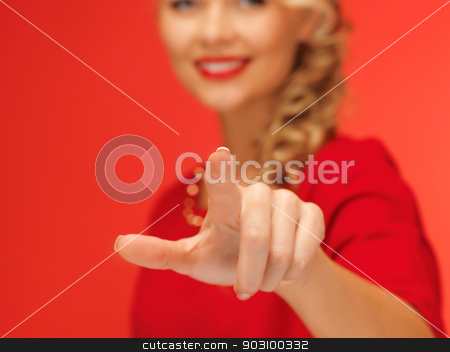 woman in red dress pressing virtual button stock photo, picture of lovely woman in red dress pressing virtual button by Syda Productions